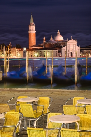night scene of Venice gondolas cityscape  photo