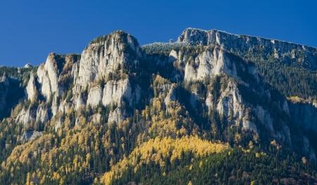 rocky mountain peak in autumn landscape photo