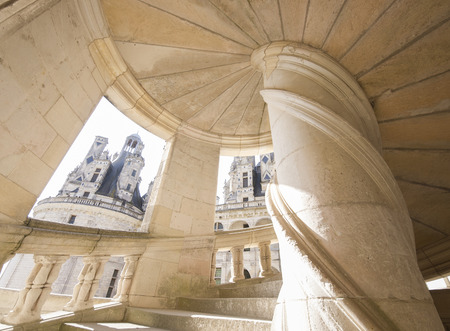 16th century: Chambord, France - September 25, 2011: Detail of an original staircase from Chambord castle, it was built in the 16th century and is one of the most recognizable chateaux in the world. wide view photo