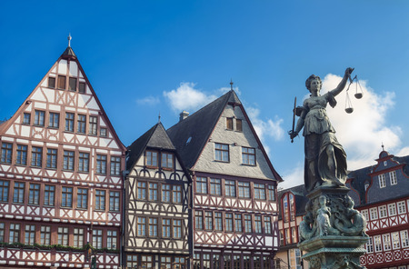 roman blind: old buildings and statue of Lady Justice statue in Frankfurt
