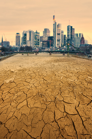 cracked earth: modern city and pollution cracked earth landscape