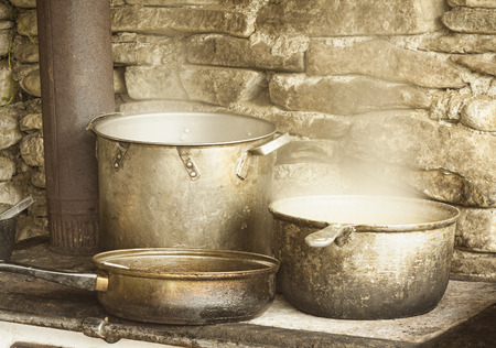 pots: preparing food in old rustic kitchen Stock Photo