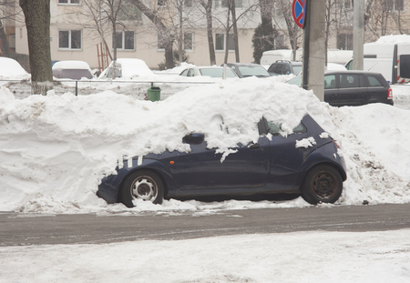 covered in snow: car covered in snow