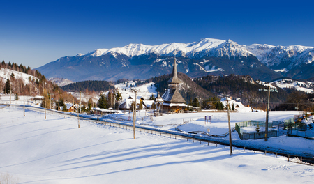Romanian mountains and wooden church