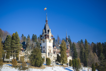 Peles castle, Sinaia Romania. winter scene with Bucegi mountains in background Editorial