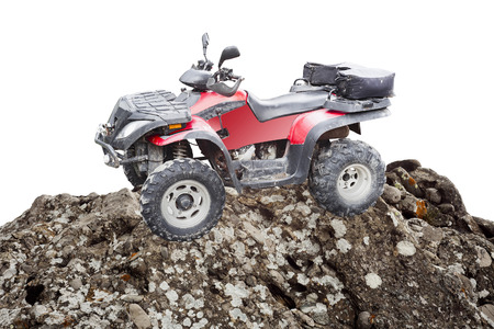 atv quad bike on a mountain rock isolated