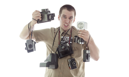 angry and upset man taking photos in the studio with vintage equipment