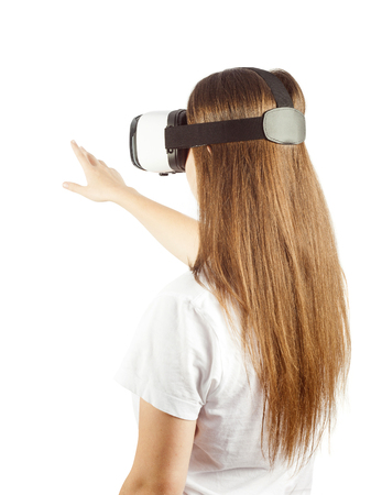 futuristic: girl with virtual reality goggles enjoying the experience