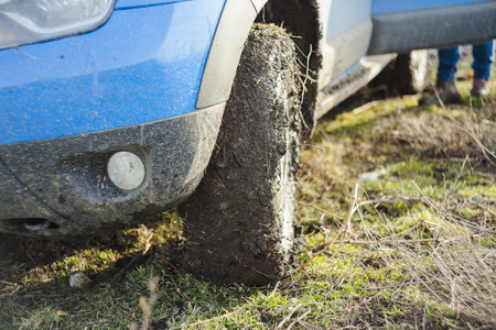 off road car full of dirt and mud. focus on the tire