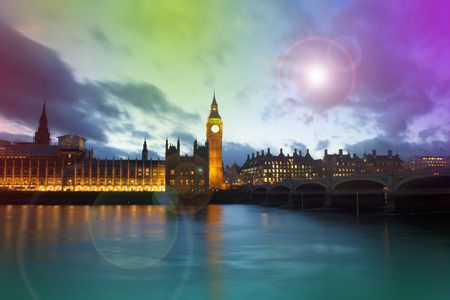 Big Ben and Westminster palace in London at night. abstract colorful image with lens flare
