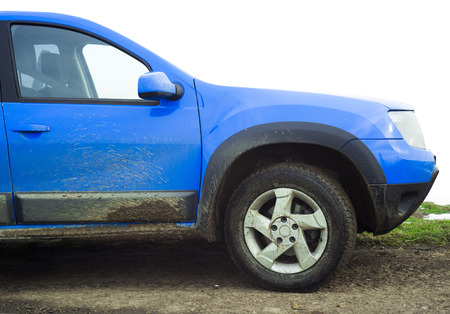 dirty blue car full of mud Stock Photo