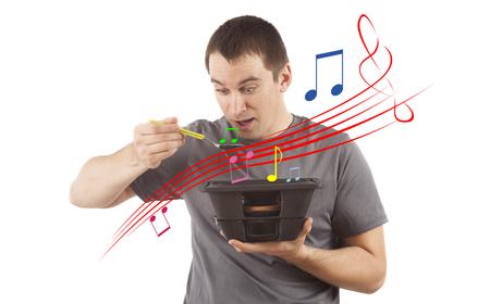 concept of man eating music from loudspeaker subwoofer