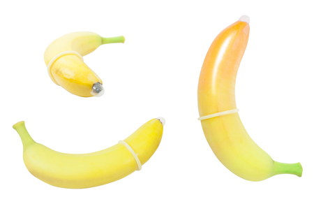 condom placed on banana isolated. concpt of sexual protectioncondom placed on banana isolated. concpt of sexual protection Stock Photo