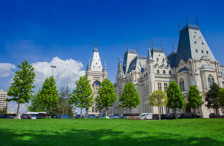 the Palace of Culture in Iasi city, Romania. green park and blue sky background Editorial