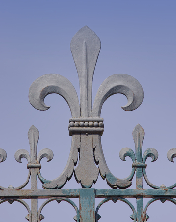 iron made fleur de lis symbol on a fence in France