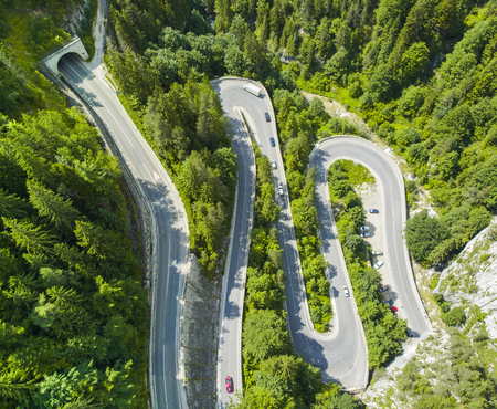 curved road with cars and beautiful forest landscape. Bicaz gorges, Romania. Aerial view from drone Фото со стока