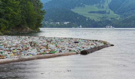 lake pollution with plastic bags in the water