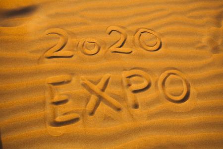 text 2020 expo for Dubai concept written in desert sand