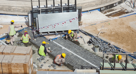 workers at construction site outdoors, pavement 写真素材