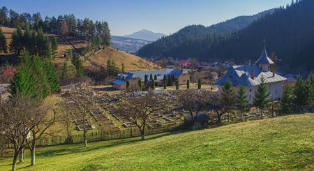 church and mountain landscape in Petru Voda, Romania