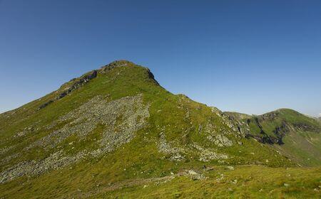 big mountain peak under clear blue sky