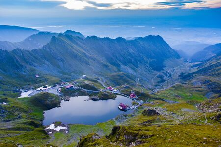 Balea lake and Transfagarasan road in Fagaras mountain. Romania at sunset Stock Photo