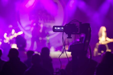 video camera recording concert show at night