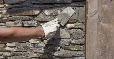 trowel tool for stone wall. man hand Stock fotó