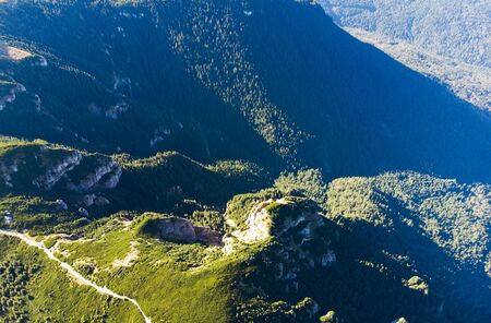 aerial view of mountain and forest. Ceahlau, Romania