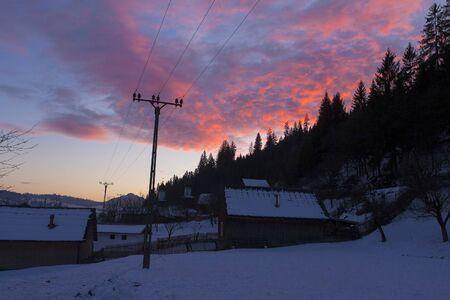 winter sunset in the village of Petru Voda, Romania
