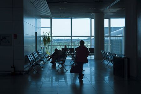 people waiting at the airport room