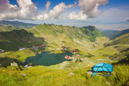 mountain landscape with backpack in Fagaras mountain, Romania