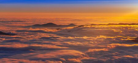 sea of clouds at sunset. Romania, Carpathian mountain Stok Fotoğraf