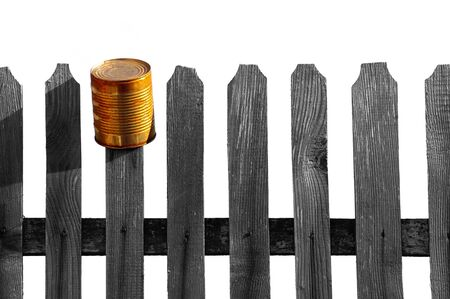 wooden fence with metal can isolated on white background