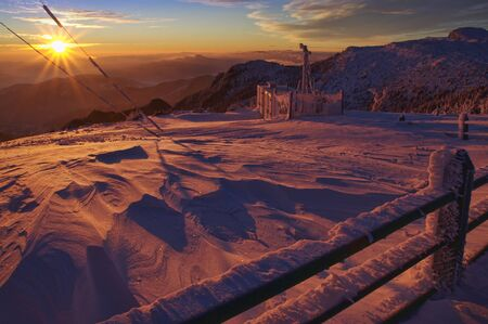 winter sunset at Ceahlau weather station. Romania