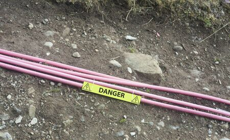 wire cables for electricity out on the ground. danger concept Stock Photo
