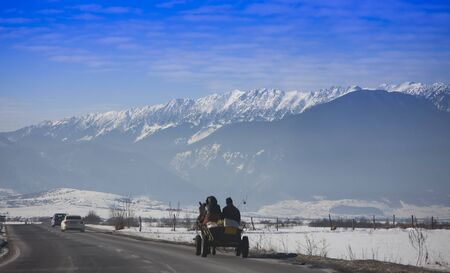 traditional cart with horses on the winter road. Romania