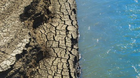 half cracked ground and soil with river, water split image Stok Fotoğraf