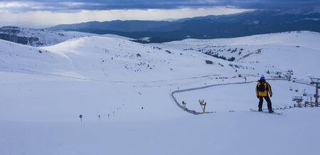 person having fun at snowboard slope in winter scene. Romania