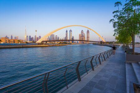 Dubai city skyline at sunset. view of Tolerance bridge Stock Photo