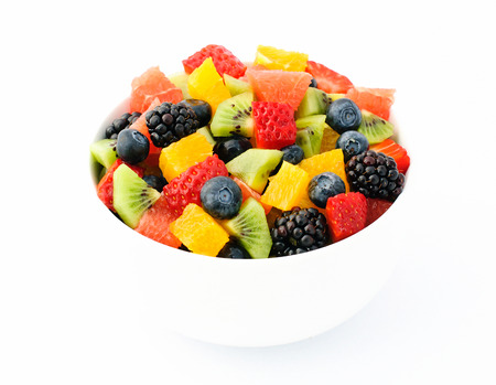 Fresh fruit salad mix in white bowl Stock Photo