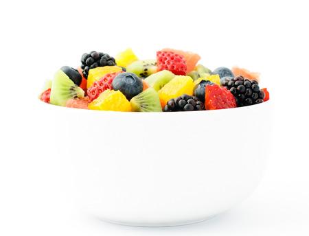 Fresh fruit salad mix in white bowl photo