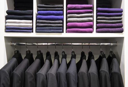 Clothes on the shelves in the store photo