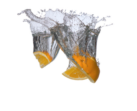 water spray: Fresh fruits, orange falling in water splash, isolated on white Stock Photo