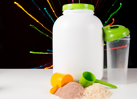 nutrients: Close up of a protein gainer powder and Scoops Stock Photo