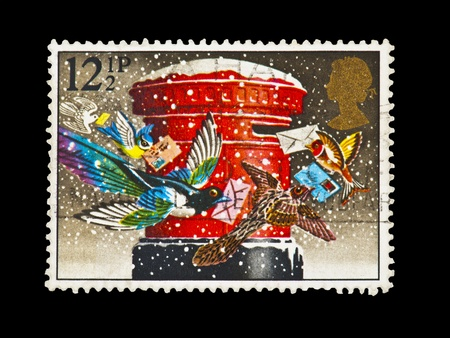 UNITED KINGDOM circa 1900's-vintage stamp of birds flying around a post box at christmas circa 1900's Stock Photo - 8652891