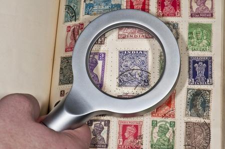 INDIA circa1900s- felatelist browsing their vintage stamps of India circa 1900s
