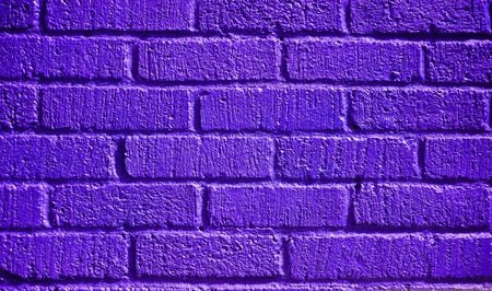 textured wall: purple textured brick wall with a grunge effect