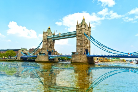 tower bridge in london with reflection in the thames photo