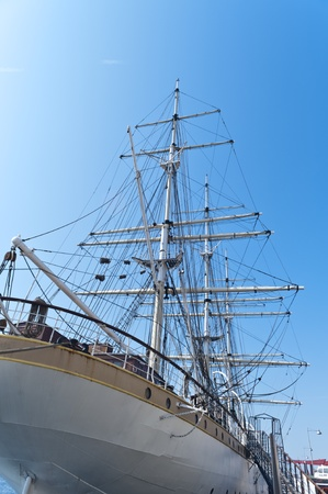 three masted: three masted ship anchored in port